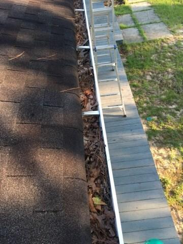 Cleaning out gutters in Aiken, SC - Before Photo